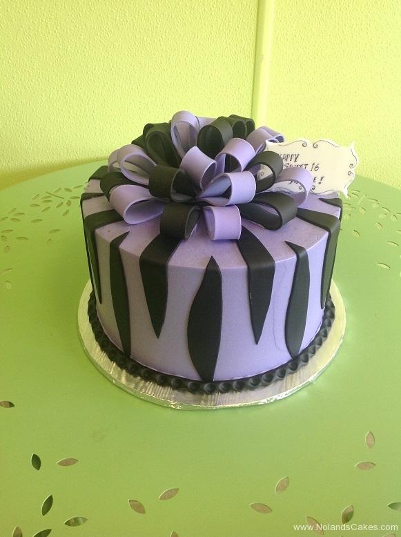 911, zebra, zebra print. animal, purple, black, ribbon, bow